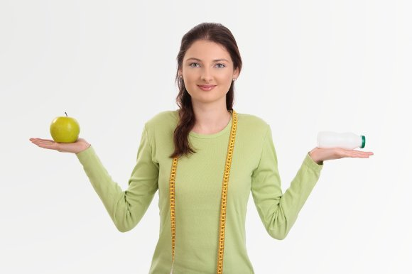woman-holding-probiotic-and-apple