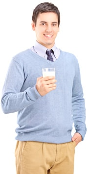 man-holding-a-glass-of-milk